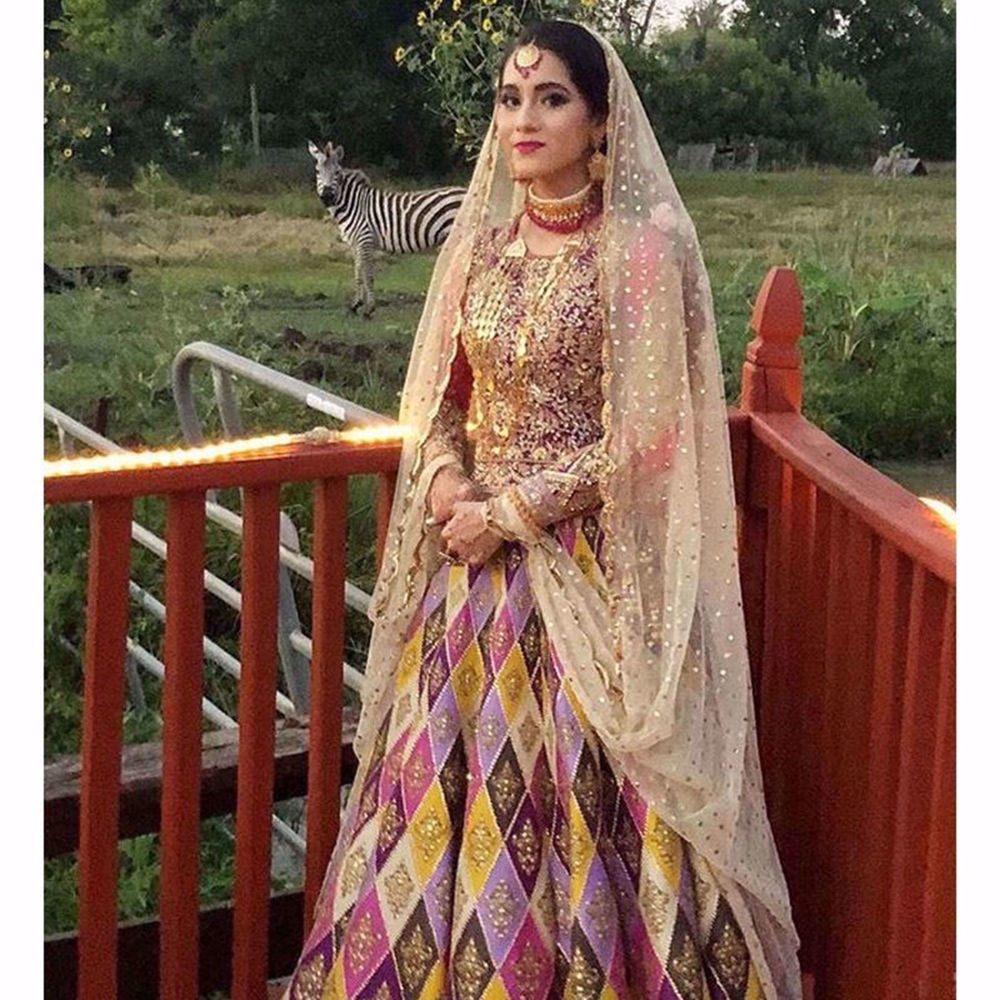 Picture of BEAUTIFUL MEHNDI BRIDE MAHIN ANSARI WEARS OUR ROSE QUARTS LEHENGA PAIRED WITH AND HEAVY EMBROIDERED CHOLI
