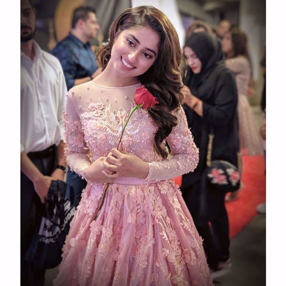 Picture of SAJAL ALY WEARS OUR PEACH PINK TULLE GOWN WITH HAND CRAFTED DETAILS