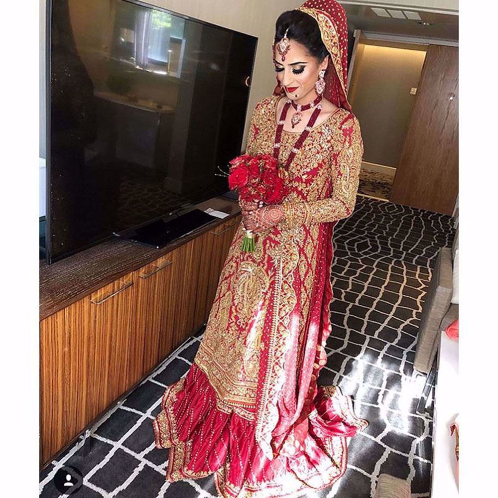 Picture of THE BEAUTIFUL BRIDE NABA IN A TRADITIONAL RED NOMI ANSARI BRIDAL