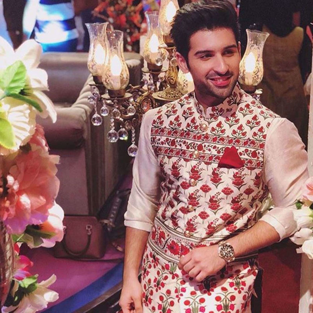 Picture of MUNEEB BUTT SPOTTED WEARING A SIGNATURE NOMI ANSARI TAILORED WAIST COAT PAIRED WITH A SILK KURTA