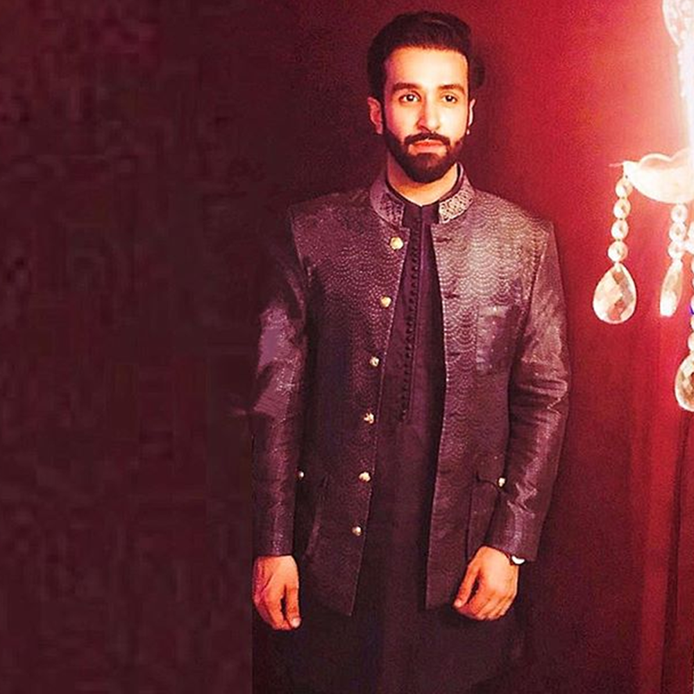 Picture of AZZFER REHMAN SPOTTED IN A PRINTED SILK JACKET BY NOMI ANSARI