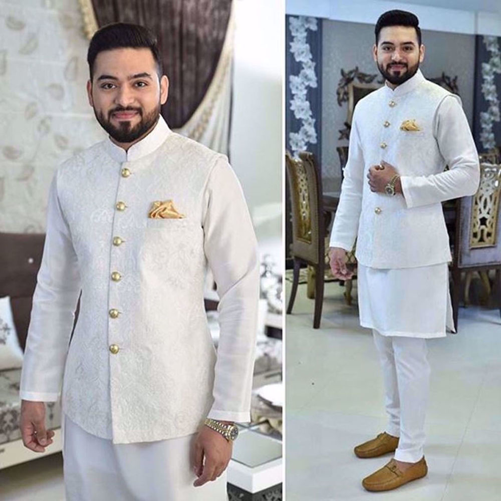 Picture of FAYYAZ EJAZ IN A WHITE EMBROIDERED WAISTCOAT PAIRED WITH STRAIGHT PAJAMAS