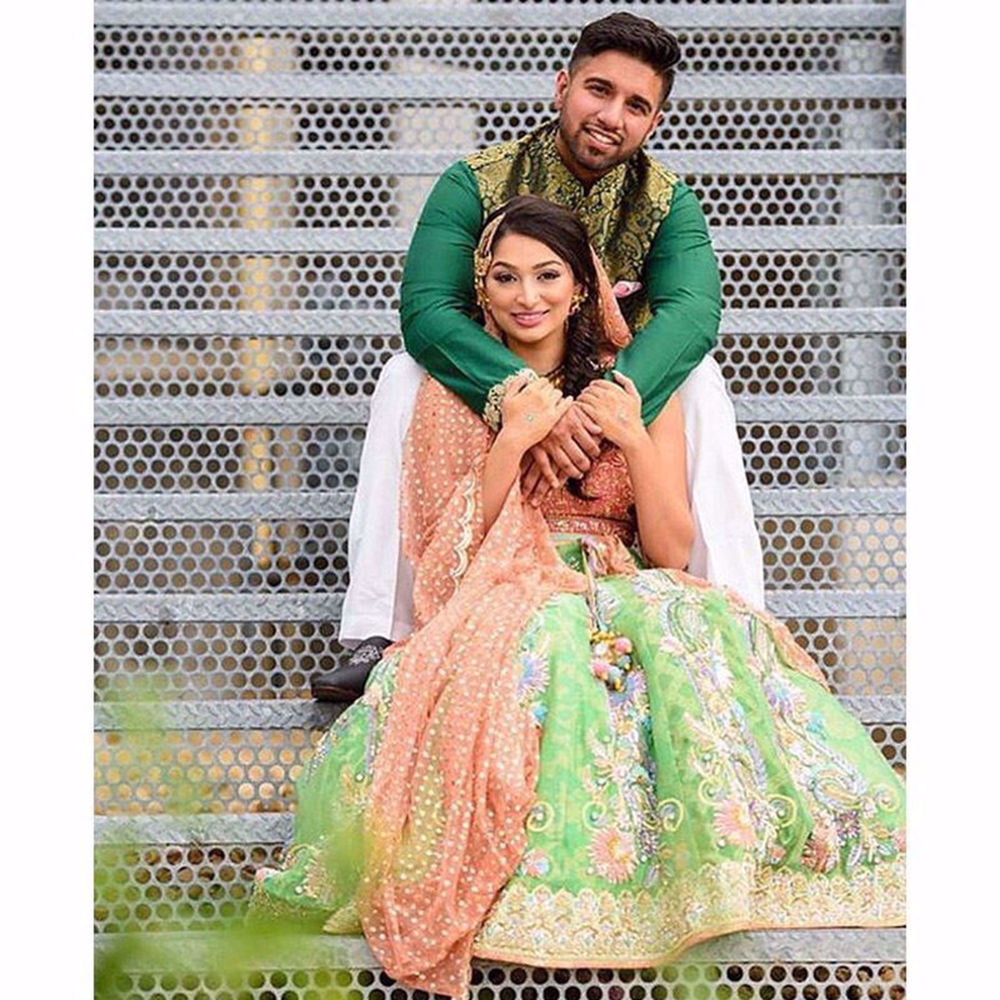 Picture of KINZA KHAN IN A LIME GREEN LEHENGA WITH PEACH DUPATTA AND CHOLI