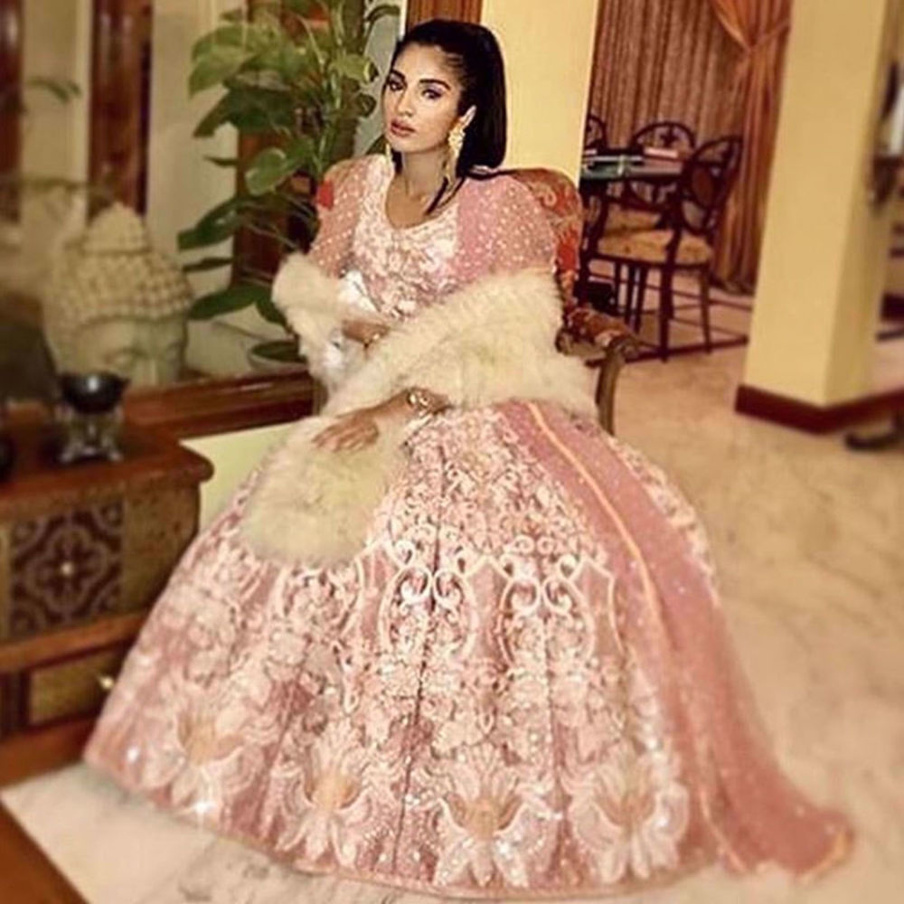Picture of SUHANA J BAIG SPOTTED WEARING A DREAM PINK EMBROIDERED LEHENGA AND CHOLI