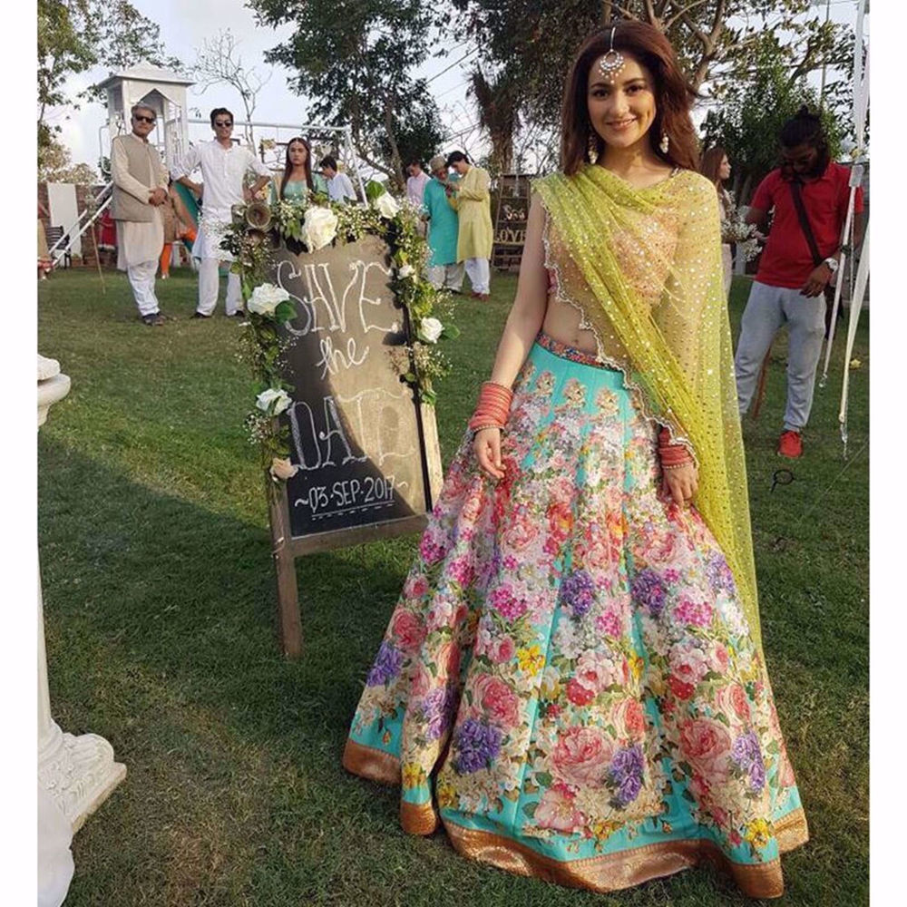 Picture of HANIA AMIR IN A CUSTOM PETAL BLOSSOM BY NOMI ANSARI