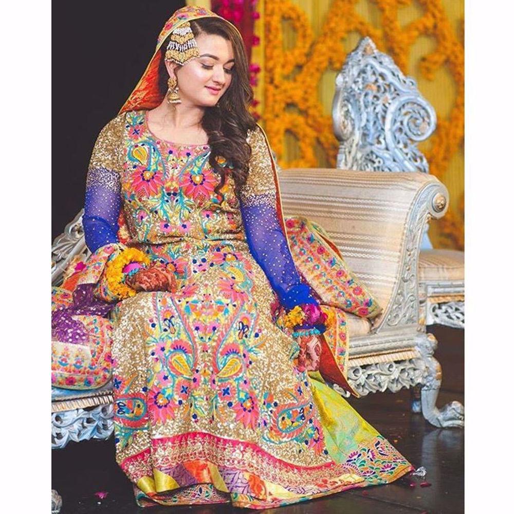 Picture of MEHNDI BRIDE IN A CUSTOM NOMI ANSARI