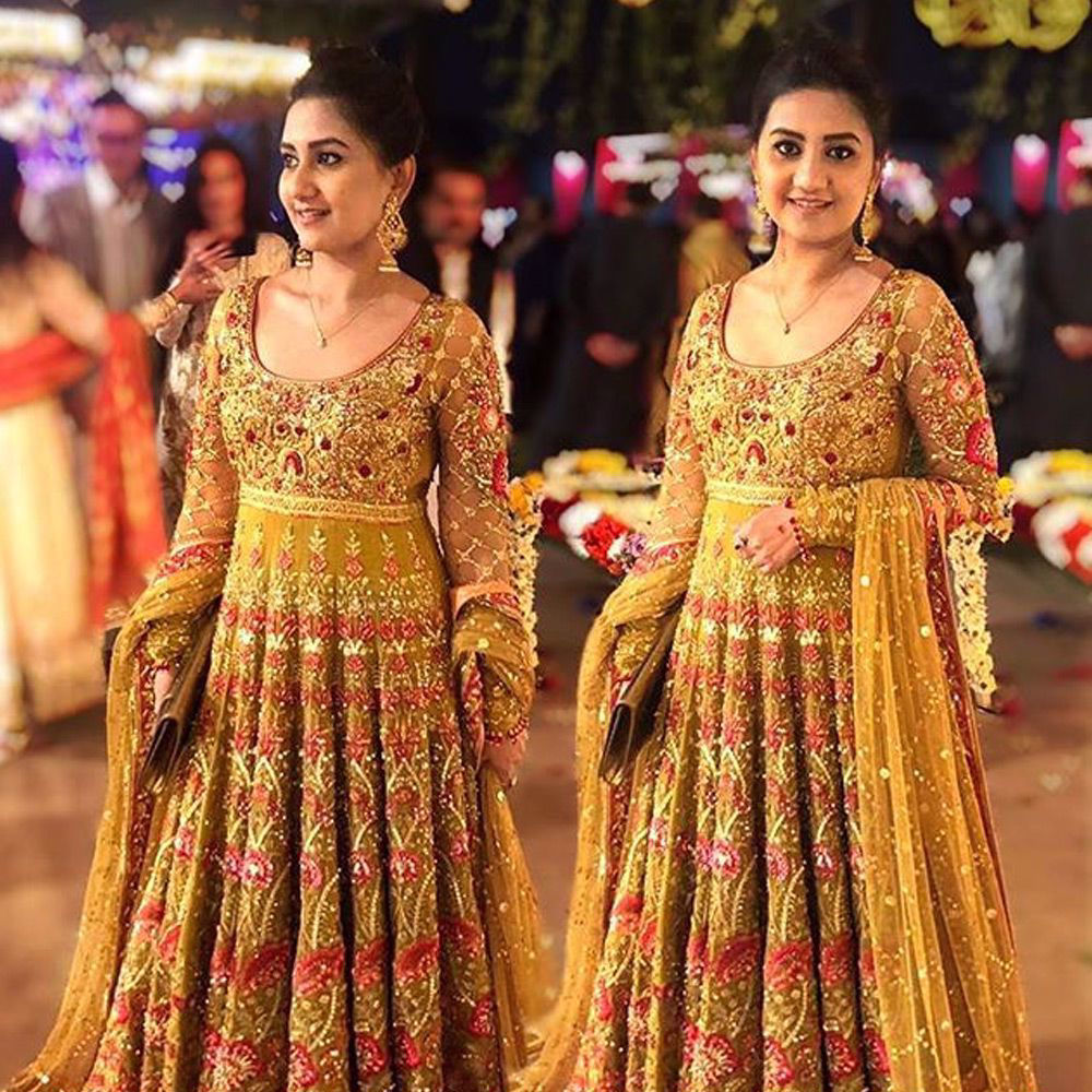 Picture of FaizaAnsari spotted in a #saffron heavily embellished peshwas with #red and #pink details and paired with a heavy tulle net #dupatta