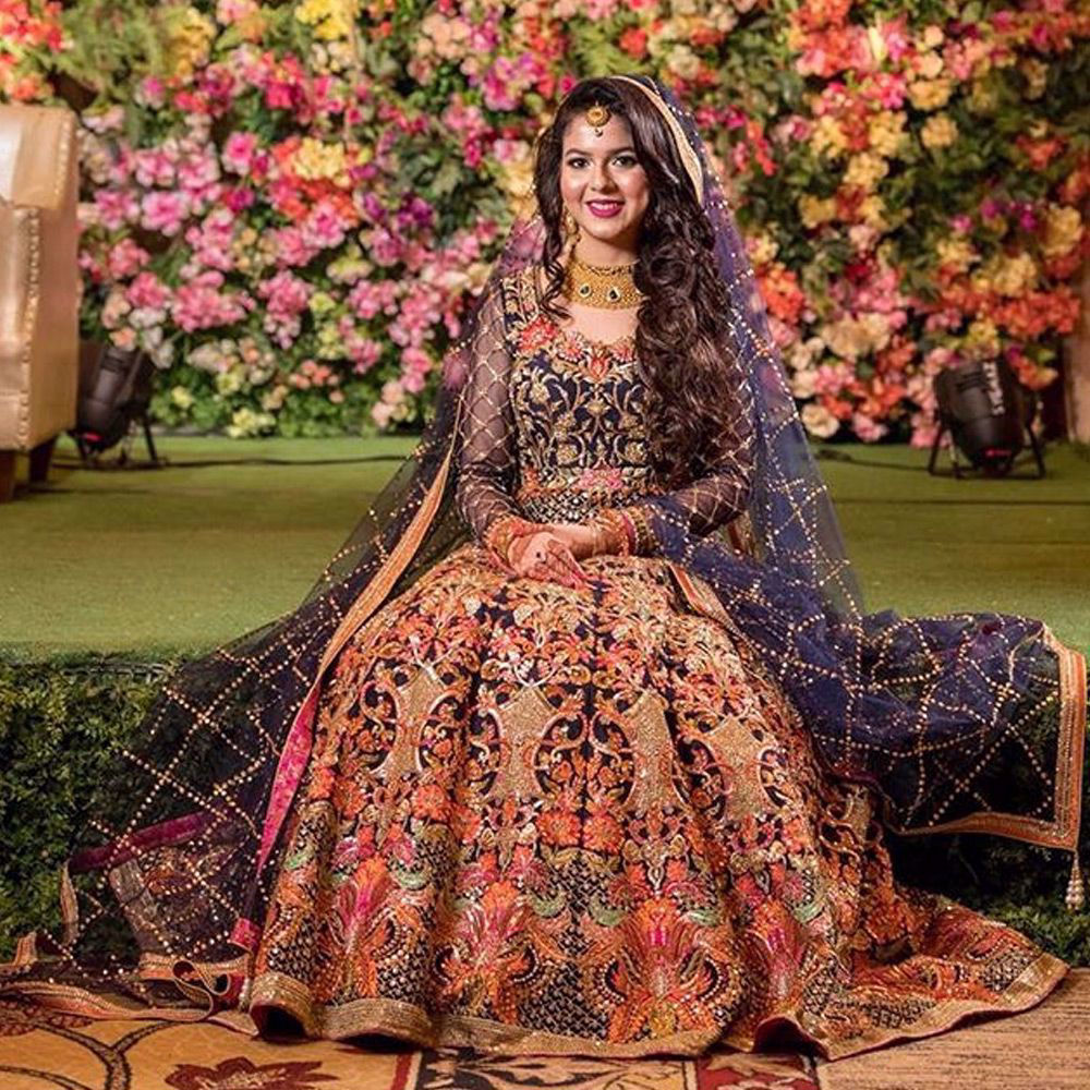 Picture of MaishaKarim from Dhaka radiates the true personification of the joyful bride in our creation Bringing out her inner glow, she dazzles in this navy ensemble.