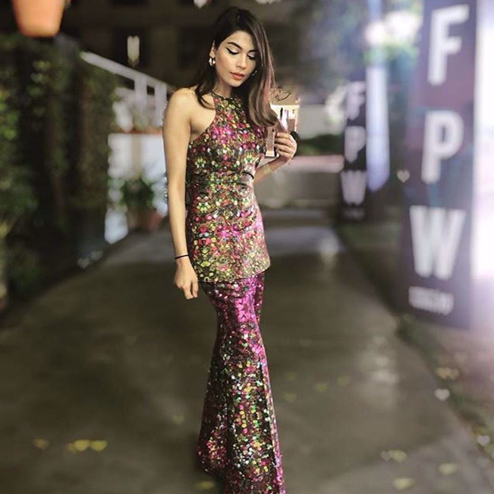 Picture of Amna Babar spotted in a printed silk halter shirt with a wide legged flared pants