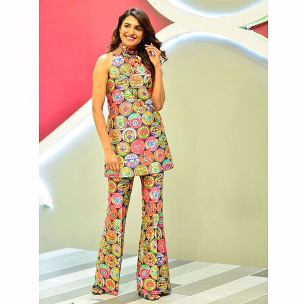 Picture of Amna ilyas wears Our retro truck art printed sleeveless A-line top paired with wide legged pants