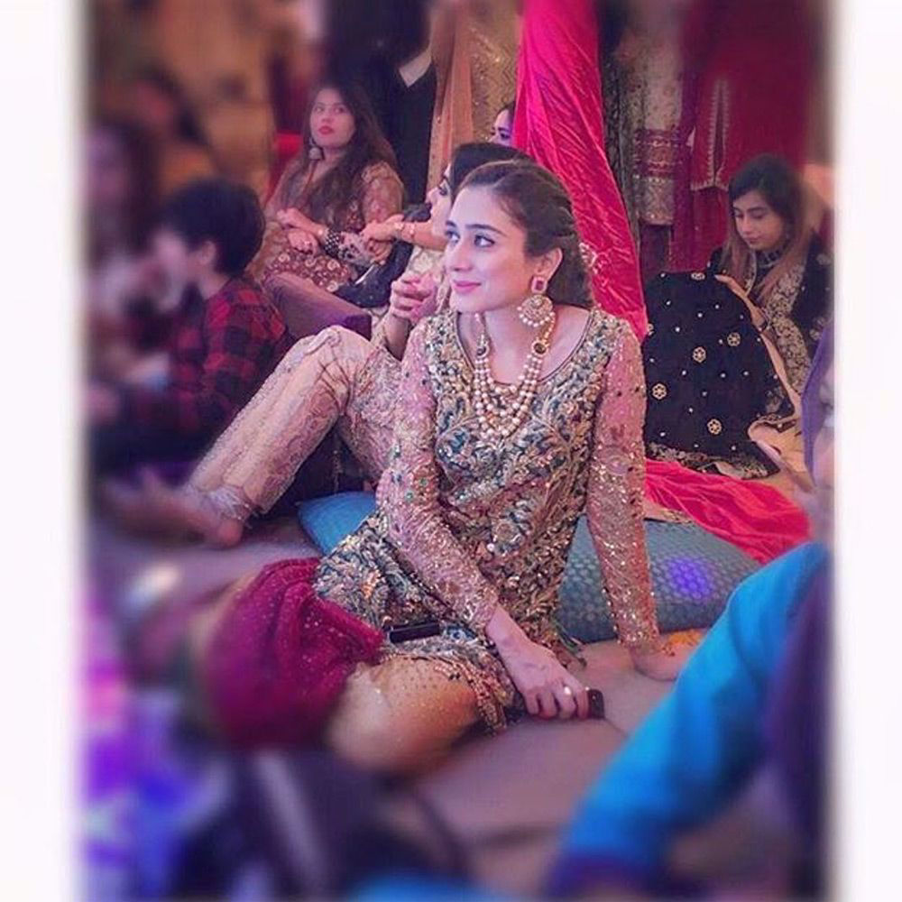Picture of Maham Faraz spotted in an #emerald jeweled embroidered shirt paired with a #saffron tulle net Dhaka pyjama and a #magenta dupatta at a wedding in karachi