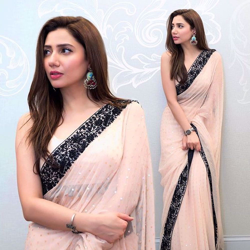 Picture of Mahira Khan looks breathtaking in a custom #NomiAnsari powder pink sari that blends sublime hues and intricate patterning in secluded patterns