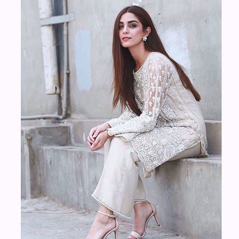 Picture of Maya Ali wears an ivory tulle net beaded mid length shirt paired with silk pants for her upcoming film promotion #pareyhutlove