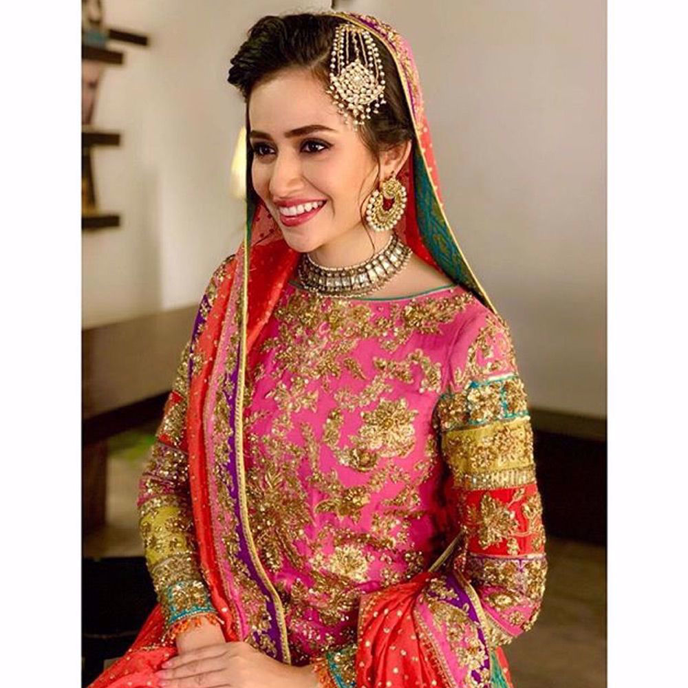Picture of Meet the bride @sanajaved.official looks million dollar in this rani pink chatapati bridal ensemble by Nomi Ansari for her upcoming Drama serial.