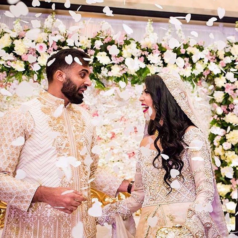 Picture of Moiz wears a #white embroidered waistcoat and kurta paired with a white straight pants by #NomiAnsari at his engagement in #usa
