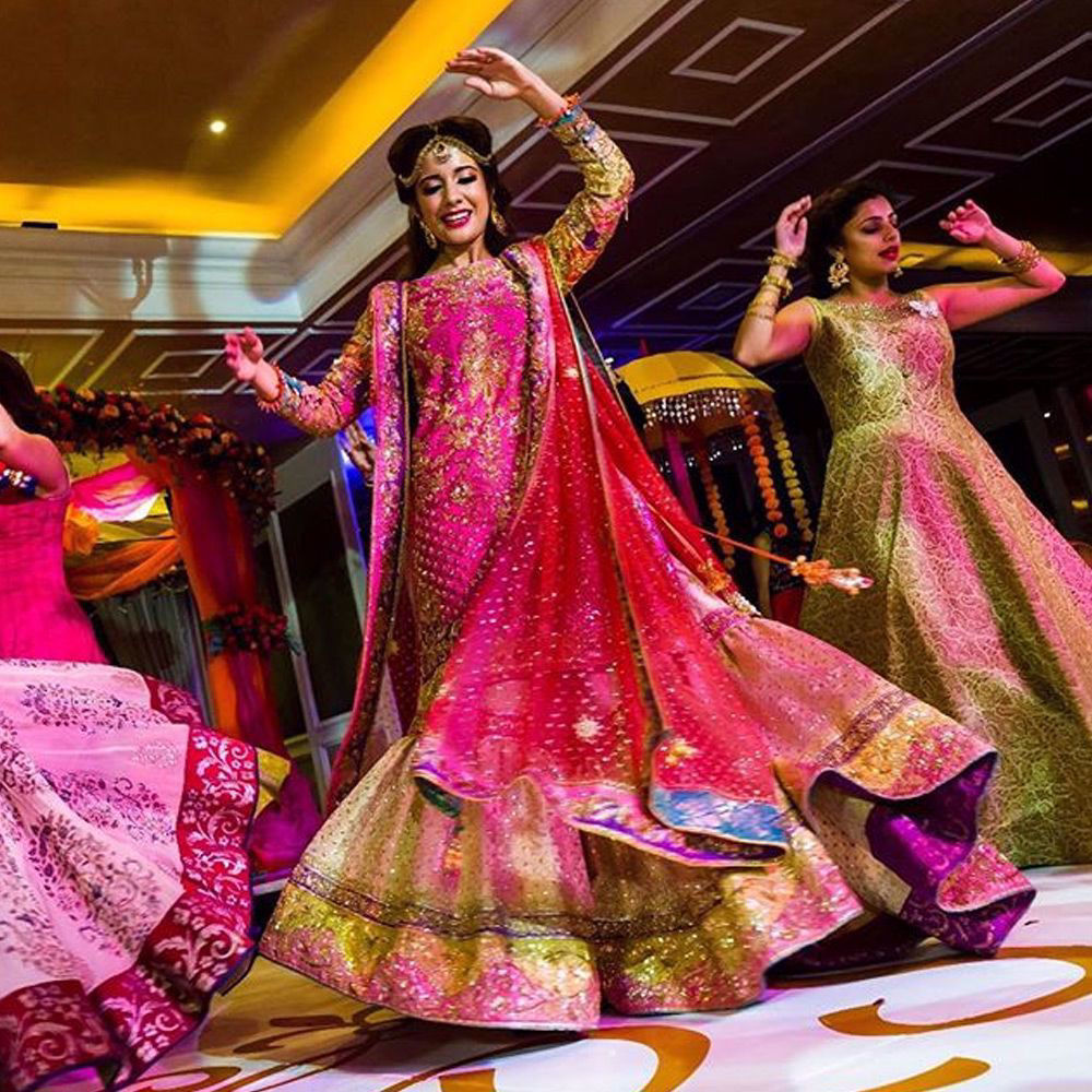 Picture of Rakhshan Butt in our traditional #hotPink Kamiz paired with a regal Farshi gharara and #Coral dupatta at her wedding reception in #Nairobi #Kenya