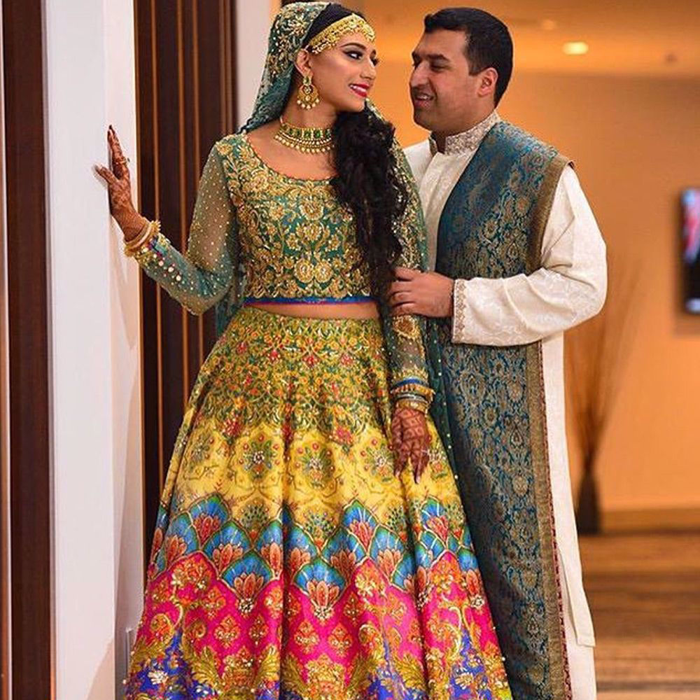 Picture of Setting the right tones for the brides, #NomiAnsari uses hues of beautiful colors to create an aura of reagilty evident through out every couture piece