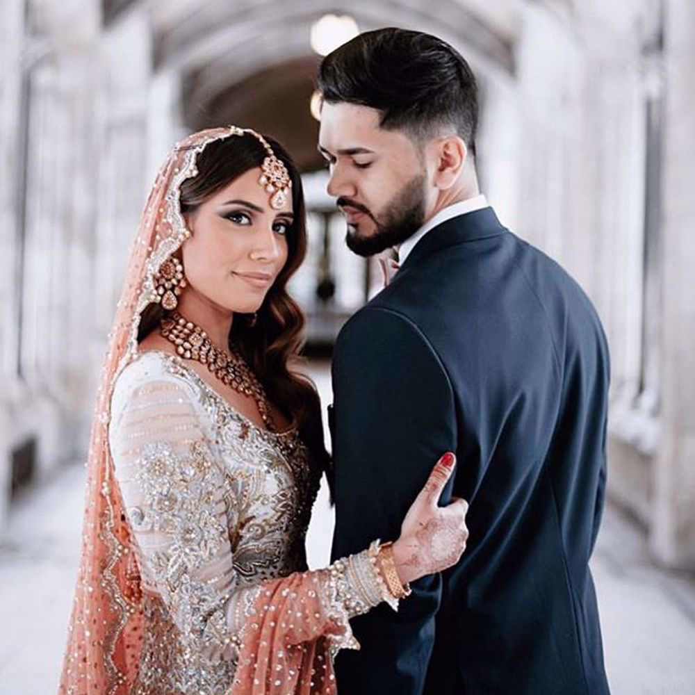 Picture of Shahbakht and Dawar at their wedding reception  pretty bride Shahbakht wears a Ganga Jamni heavily embroidered Anarkali paired with a peach scallop dupatta and a banarsi lehenga.