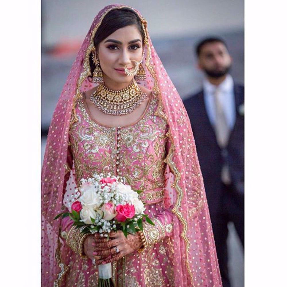Picture of The beautiful #bride Durezehra Naqvi wears our signature long tulle gown with an embellished #lehenga and scalloped dupatta in #Florida #USA