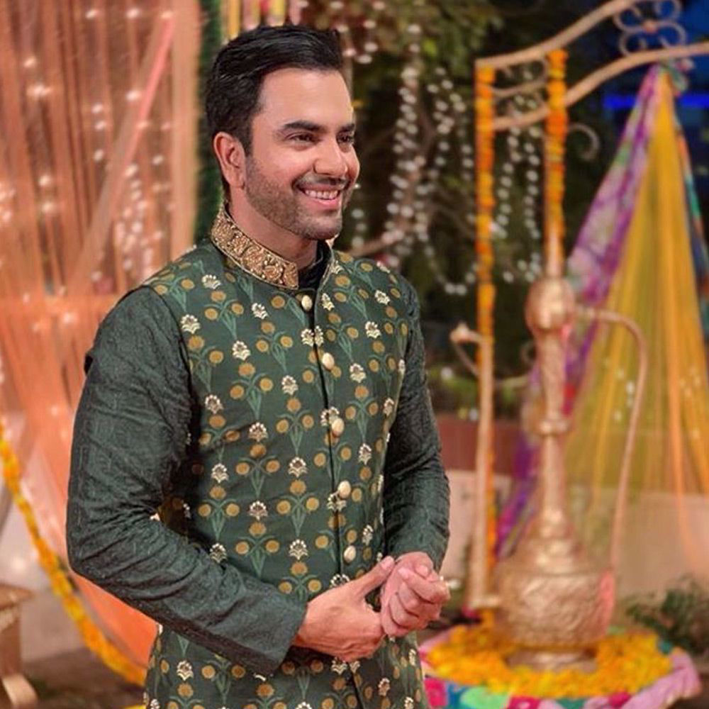 Picture of The rockstar @calljunaidkhan wears an embellished printed deep olive waistcoat paired with an embroidered kurta and straight pants