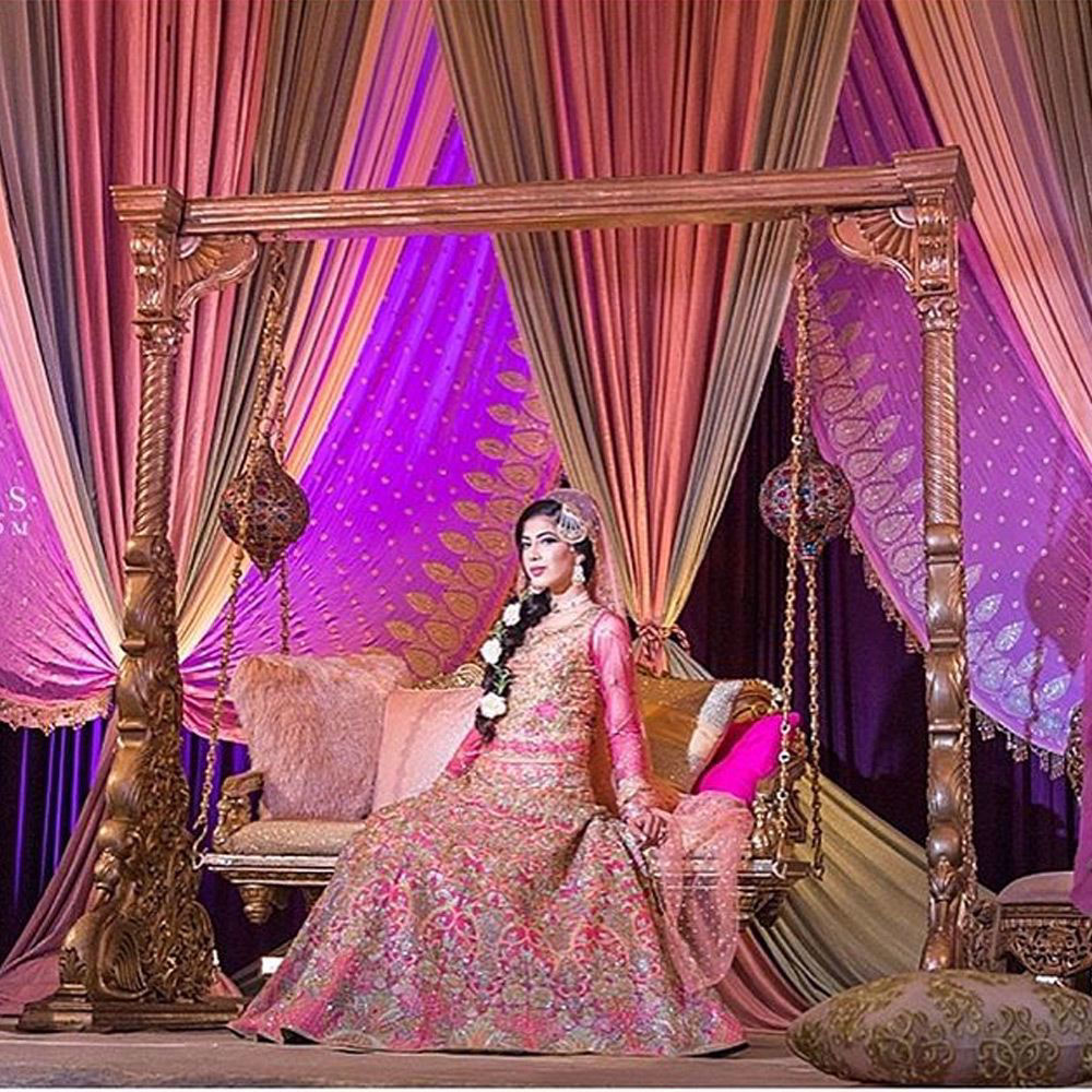Picture of The stunning #Zoya at her #Mehndi in a #CandyPink #NomiAnsari lehenga Choli