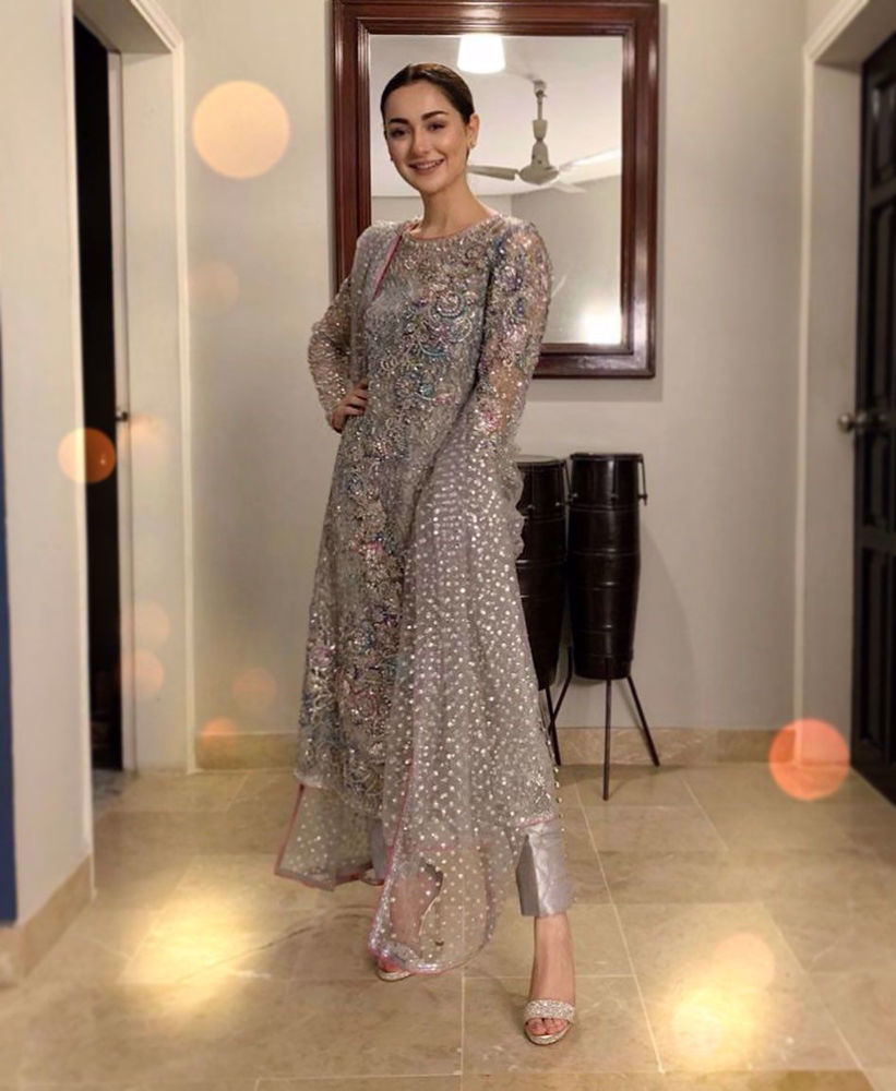 Picture of Hania Aamir lit up the night in a super sparkly number from our latest formals range! With a printed lining, the net features an intricate sequinned jaal with a floral pattern atop it