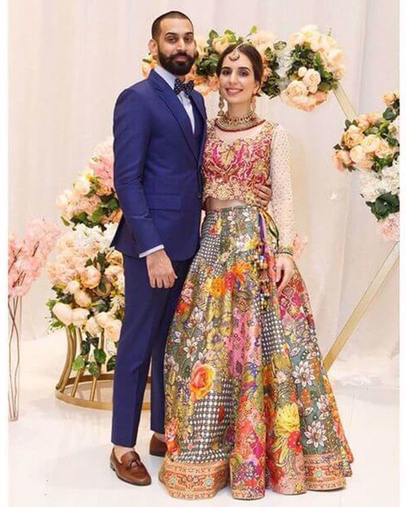 Picture of Dora Soomro wears a fun customized lehnga choli by us where a cool checkered lehnga is matched with a hot pink and gold embellished choli