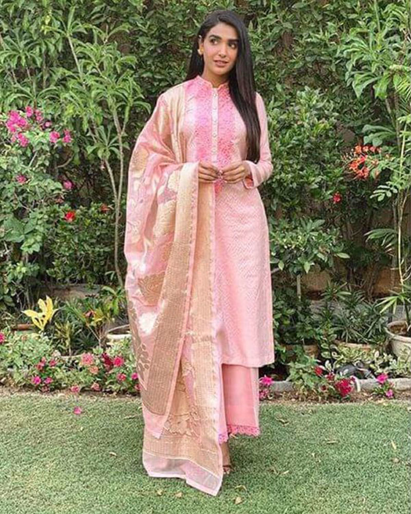 Picture of Pretty pink on pink embroidery finished with sparkling buttons and an elegant organza dupatta