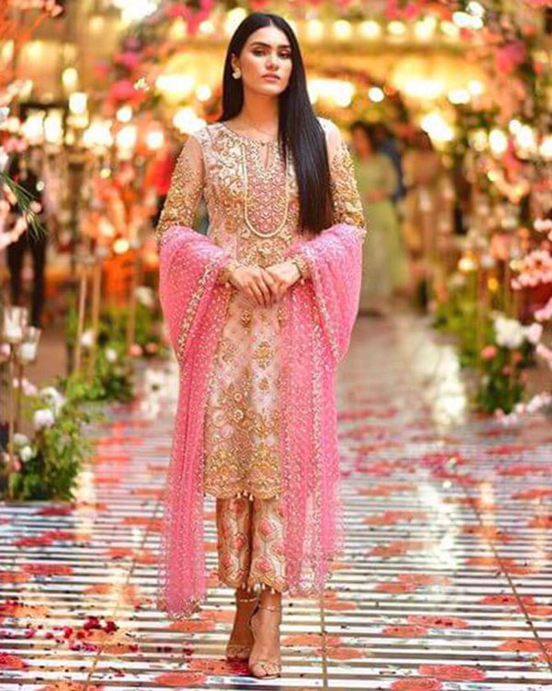 Picture of Roshanay dolled up in a pretty ivory, gold and pink combination, paired with printed pants and a net chann dupatta