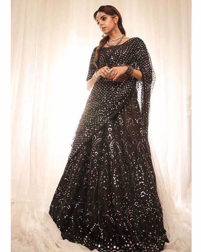 Picture of Sanam makes a statement in our solid black lehnga choli with heavy mirrorwork and our signature dupatta