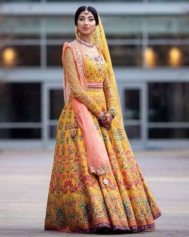 Picture of Sara wears one of the most loved numbers from our vibrant lehnga cholis, for her mehndi in USA