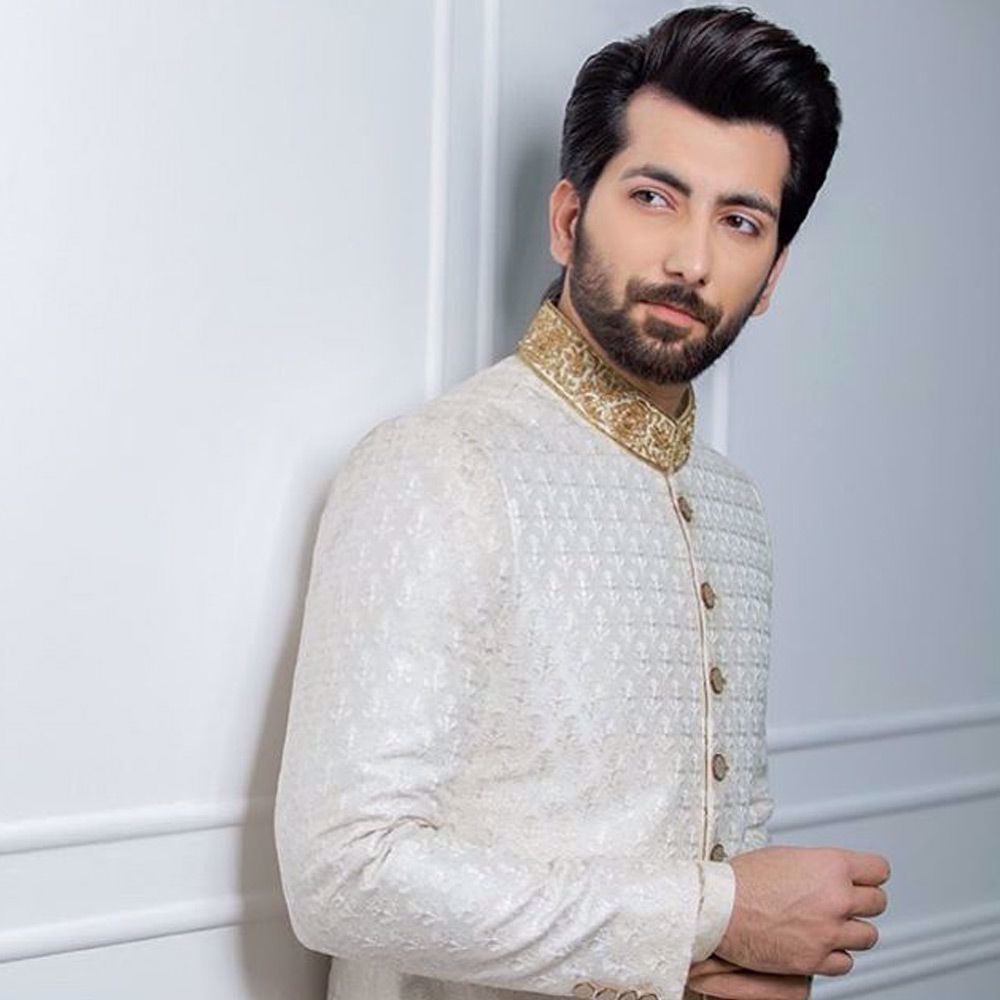 Picture of Ali Khan wears our signature White on White embroidered classic Sherwani with gold zardozi collar paired with straight pants.