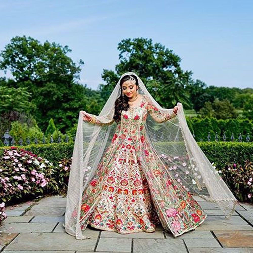 Picture of Asiya zehra Pathan stuns in this beautifully hand crafted net front open jacket. The lehnga and the jacket is adorned with hand embroidered florals. She drapes an ivory embellished net dupatta.