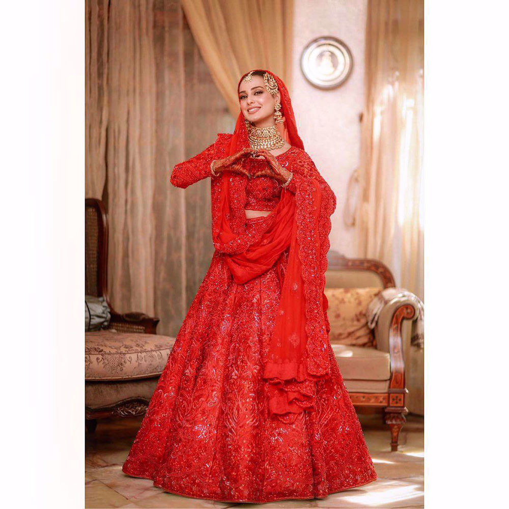 Picture of Iqra - a distinct all red full sleeved choli and heavy lehnga, fully bedazzled with red-on-red embroidery and hand worked embellishments that include sequins, gemstones and more
