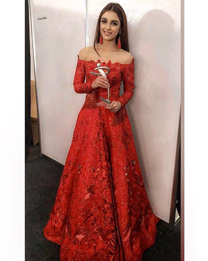 Picture of #Throwback to this iconic moment when Maya Ali was awarded an LSA for 'Mann Mayal'. The talented star wears a full length off shoulder gown custom made especially for the occasion