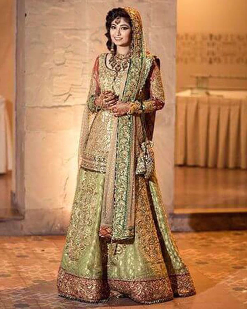 Picture of A dazzling, gold bridal ensemble for a traditional look in our signature aesthetic of immaculate craftsmanship and colour play