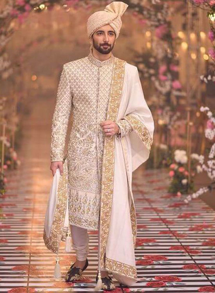 Picture of A richly worked gold and silver handworked sherwani, finished with an embroidered shawl and turban for Ali's grand look
