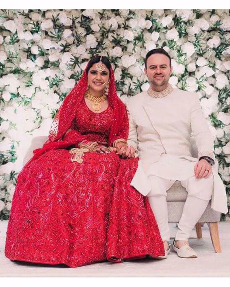 Picture of Alessandro and Alicia look truly lovely, with the bride lighting up the night in our elaborate red-on-red, handcrafted lehnga and choli