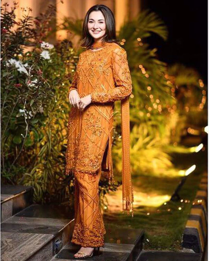 Picture of Hania wears a super sleek ochre number, with self embellishments and a touch of pink gemstones and a pretty sequinned stole to match