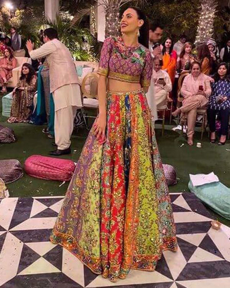 Picture of Mareeha Safdar wears a super colourful, multi-paneled lehnga with rich mirror work, paired with a cute printed choli