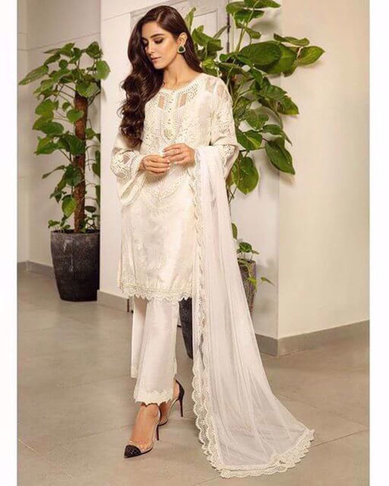 Picture of Maya looking ever graceful in a sleek white-on-white number with a smart embroidered neckline design and embroidered sleeves