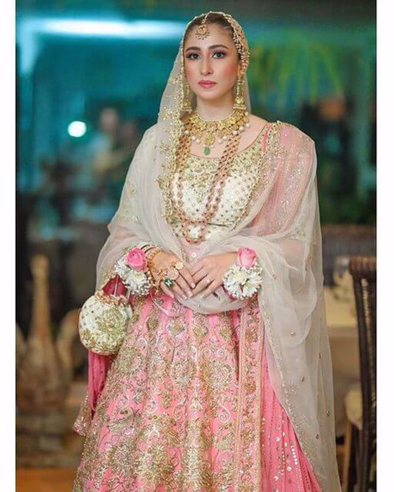 Picture of Our favourite celebrity stylist wears a gorgeous combination of rani pink and ivory, with the most bedazzling gold kaam, paired