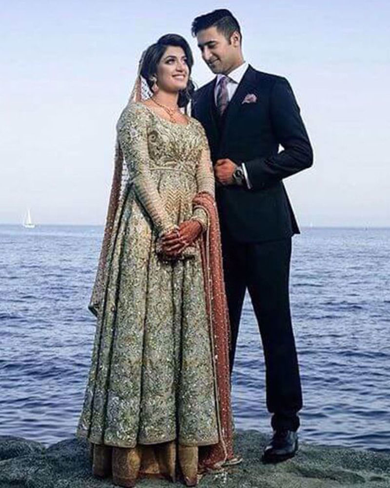 Picture of The beautiful bride wears our signature pishwaas with gold and silver kaam on an ivory base, paired with a peach chiffon dupatta to give it a subtle colour accent