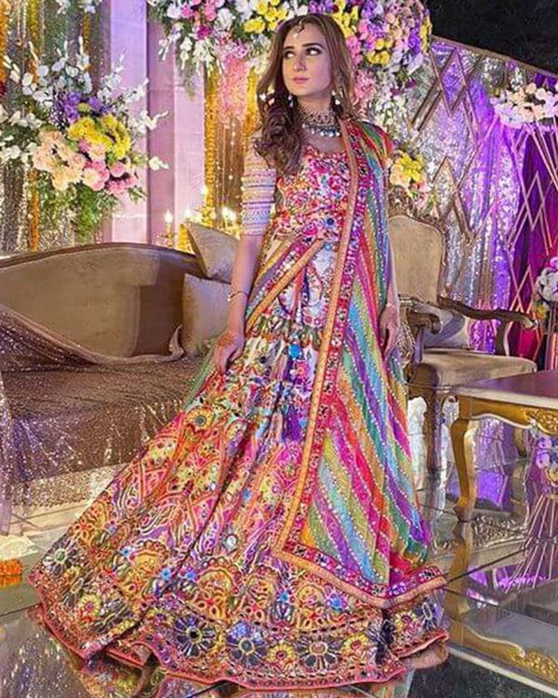 Picture of With dazzling colours and intricate embroidery, Minhal's look is complete with a gorgoues multi coloured, mirror worked dupatta