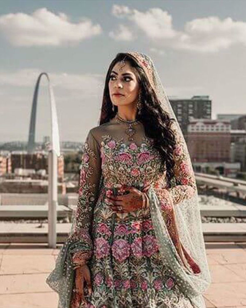 Picture of Yamna Sheikh in a divinely detailed mint blue and pink bridal lehnga and peplum